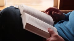 Man finished reading and closed the book Stock Footage