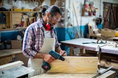 Carpenter marking on wooden plank Stock Photos