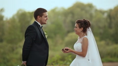 The bride and the groom throw forest cones - stock footage