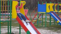 Girl riding a roller coaster at the playground - stock footage