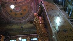 Buddha statue in the Gangaramaya Buddhist temple in Colombo, Sri Lanka. Stock Footage