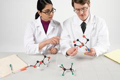 Scientists with molecule models Stock Photos