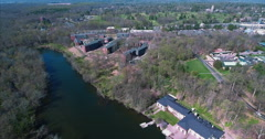 Flyover Ideal Lake Towards Magie Apartments On Princeton University Campus Stock Footage