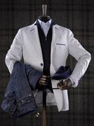 Dummy wearing elegant male suit isolated on checkered background - stock photo