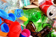 Recyclable garbage consisting of glass, plastic, metal and paper. Stock Photos