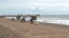 People walk by the seaside in Colombo, Sri Lanka. Stock Footage