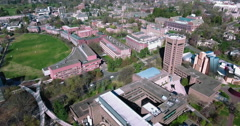 Fly Backwards Shot Of Princeton University Over Football Stadium & TrackField Stock Footage