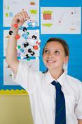 Girl holding molecule model Stock Photos