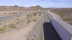 Cars and trucks driving on busy highway, freight semi trucks transporting goods - stock footage