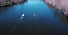 Arial Shot Of Princeton Rowing Team With Cherry Blossom Trees In View - stock footage
