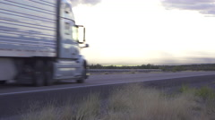 Cars and trucks driving on busy highway, freight semi trucks transporting goods Stock Footage