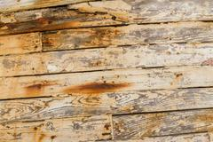 Closeup of Wood Planks on Derelict Wooden Fishing Boat Wreck - stock photo