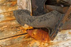 Anchor on Derelict Wooden Fishing Boat Wreck closeup - stock photo
