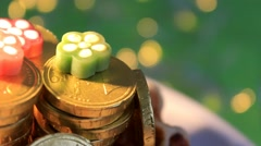 Green background -  Chocolate Coins - Euro - 07 Stock Footage