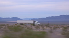 CLOSE UP: Freight semi truck driving and transporting goods on busy highway Stock Footage