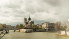 Zooming timelapse of Notre Dame in Paris sourrounded by the Seine 4K Stock Footage