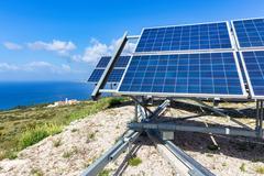 Blue solar panels at coast near sea in Kefalonia Greece Stock Photos