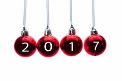Four red christmas balls with new year 2017 numbers Stock Photos