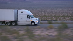 CLOSE UP: Freight semi truck driving and transporting goods on empty highway Stock Footage