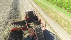 unloading sugar beet from trailer aerial view - stock footage