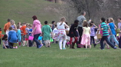 Kids collecting eggs at easter hunt in Fairborn Ohio 4k - stock footage