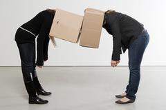 Women with boxes on their heads Stock Photos
