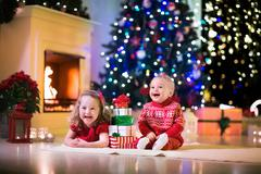 Kids playing at fireplace on Christmas eve - stock photo
