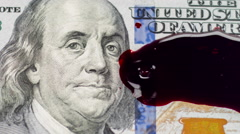 One hundred dollar bill with blood dripping on face slow motion - stock footage