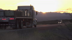 Cars and freight transporting trucks driving on busy highway after the sunset Stock Footage