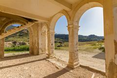 Arches and stairs of derelict Agios Georgios Church, Davlos Cyprus Stock Photos