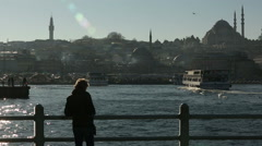 Woman photographer takes pictures of Golden Horn Stock Footage