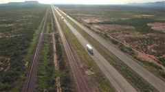 AERIAL: Cars and transportation semi trucks driving on busy highway Stock Footage
