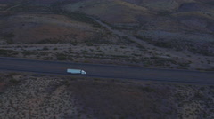 AERIAL: Flying high above freight semi truck transporting goods on empty highway Stock Footage