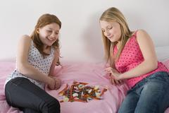 Teenage girls and a pile of sweets - stock photo
