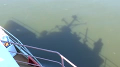 Shadow of the ship glides over the surface of the water. - stock footage