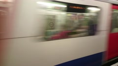 The London tube train is arriving to the station - stock footage