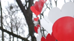 Love heart balloons on sky background. Paper red hearts decoration in the autumn - stock footage