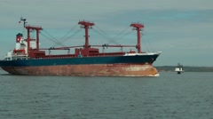 Empty cargo ship running on the background of the shore. Stock Footage