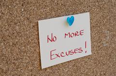 NO EXCUSES. Motivational concept written on a note - stock photo