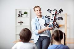 Positive father holding robot Stock Photos