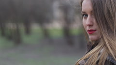 Young stylish hipster girl with red lips softly touching beautiful face. Autumn - stock footage