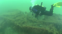 A diver swims over the sunken vessel. Stock Footage