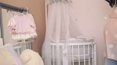 Pregnant woman looking on clothes in a tender future baby room. 4k Stock Footage
