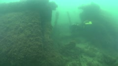Enters the compartment of the sunken vessel. - stock footage