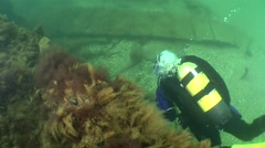 The diver floats along the board of the wreck. Stock Footage