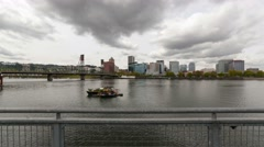 Time lapse of clouds over city skyline along Willamette River in Portland Or 4k Stock Footage