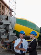 Engineers by cement mixer Stock Photos