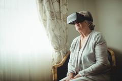 Senior woman using an oculus rift Stock Photos