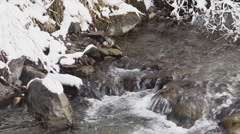 Creek in Snow covered Landscape of Gries am Brenner Stock Footage