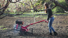 Gardening. The  young girl working in the garden Stock Footage